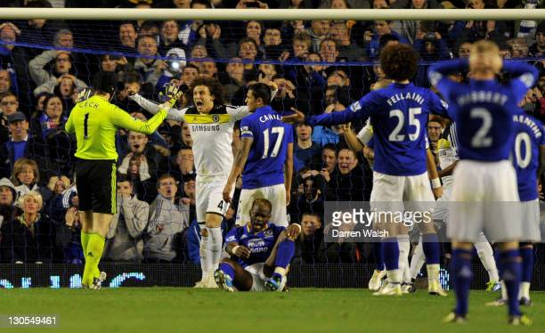 Petr Cech of Chelsea is congratulated by team mate David Luiz after saving the penalty of Leighton Baines of Everton during the Carling Cup Fourth...