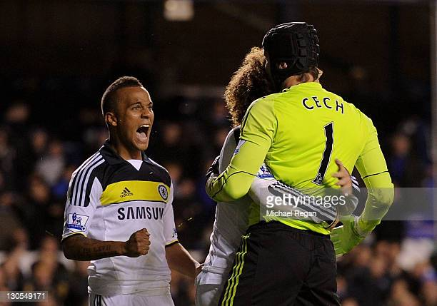 Petr Cech of Chelsea is congratulated by team mates David Luiz and Ryan Bertrand after saving the penalty of Leighton Baines of Everton during the...