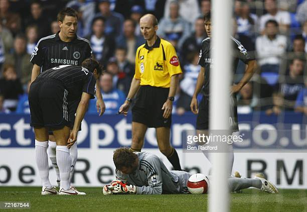 Petr Cech of Chelsea is injured during the Barclays Premiership match between Reading and Chelsea at the Madejski Stadium on October 14 2006 in...