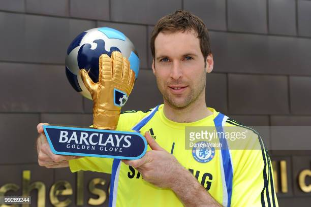 Petr Cech of Chelsea poses with the Barclays Golden Glove award after a training session at the Cobham Training ground on May 13 2010 in Cobham...