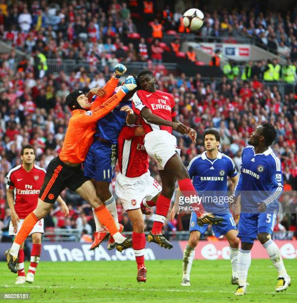 Petr Cech of Chelsea punches clear from Kolo Toure of Arsenal during the FA Cup sponsored by EON Semi Final match between Arsenal and Chelsea at...