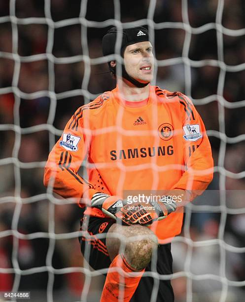 Petr Cech of Chelsea reacts to conceding Dimitar Berbatov's goal during the Barclays Premier League match between Manchester United and Chelsea at...