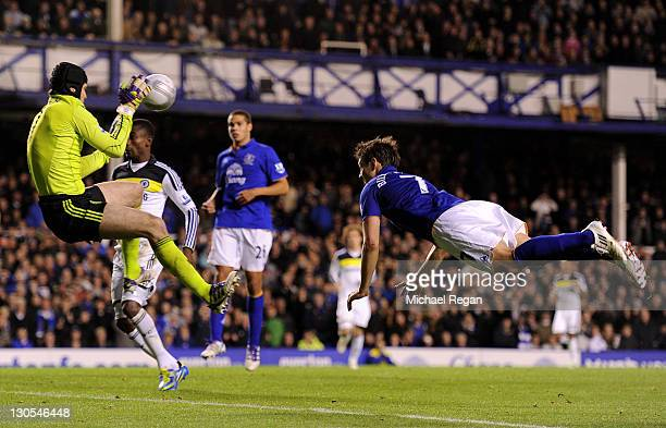 Petr Cech of Chelsea saves the attempt on goal of Diniyar Bilyaletdinov of Everton following his penalty save from Leighton Baines during the Carling...