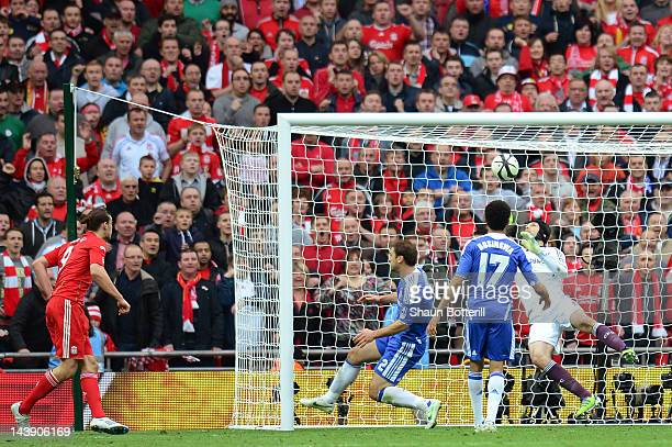 Petr Cech of Chelsea saves the ball on the line as Andy Carroll of Liverpool turns to celebrate a goal that was not given during the FA Cup with...