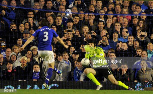 Petr Cech of Chelsea saves the penalty kick of Leighton Baines of Everton during the Carling Cup Fourth Round match between Everton and Chelsea at...