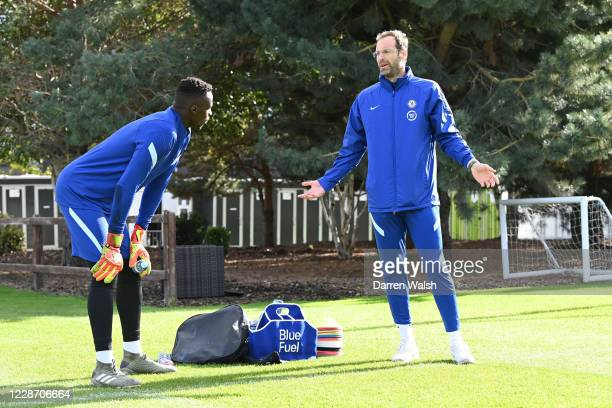 Petr Cech of Chelsea talks to Edouard Mendy of Chelsea during an individual training session at Chelsea Training Ground on September 25, 2020 in...