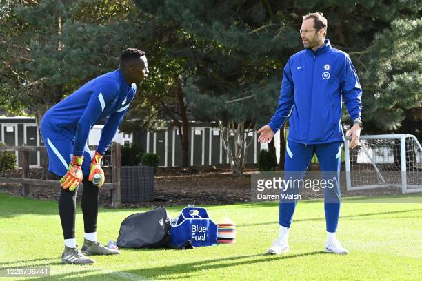 Petr Cech of Chelsea talks to Edouard Mendy of Chelsea during an individual training session at Chelsea Training Ground on September 25 2020 in...