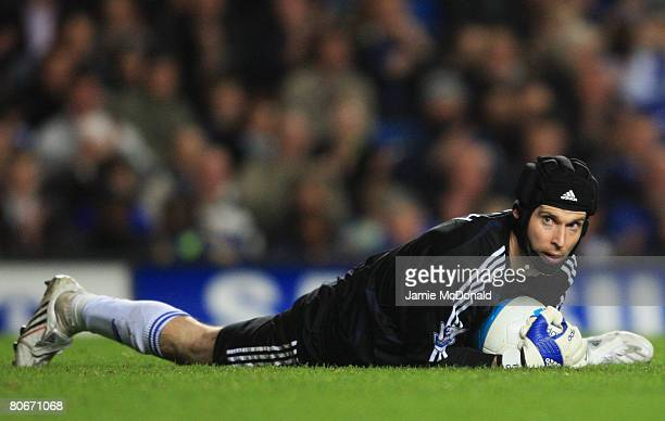 Petr Cech of Chelsea wears a protective face guard during the Barclays Premier League match between Chelsea and Wigan Athletic at Stamford Bridge on...