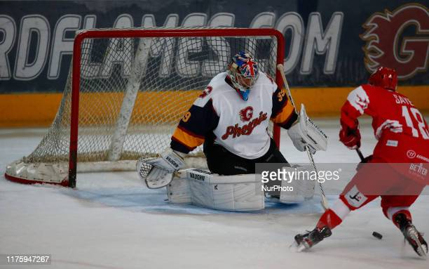 LR Petr Cech of Guildford Phoenix Ex Arsenal and Chelsea Player and Loris Taylor of Swindon Wildcats during National Ice Hockey League between...