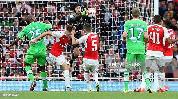 Petr Cech the Arsenal goalkeeper punches the ball clear during the Emirates Cup match between Arsenal and VfL Wolfsburg at the Emirates Stadium on...