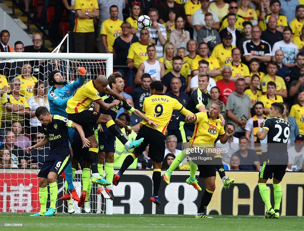 Petr Cech, the Arsenal keeper punches the ball clear during the Premier League match between Watford and Arsenal at Vicarage Road on August 27, 2016 in Watford, England.