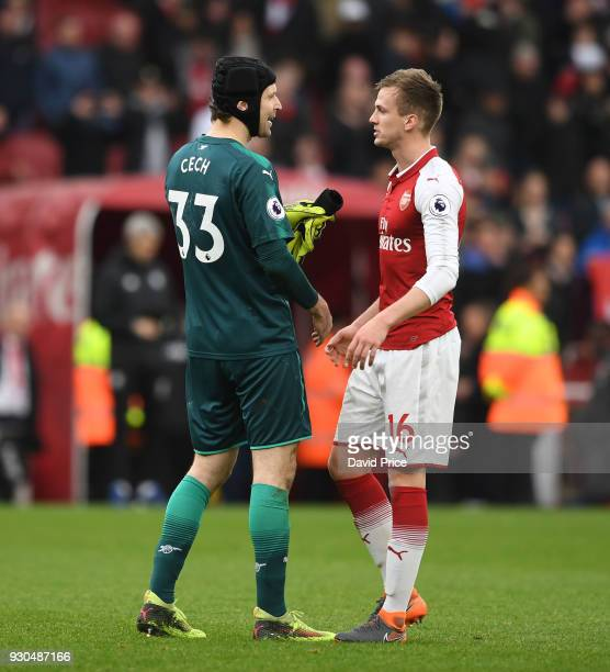 Petr Cech with Rob Holding of Arsenal after the Premier League match between Arsenal and Watford at Emirates Stadium on March 11 2018 in London...