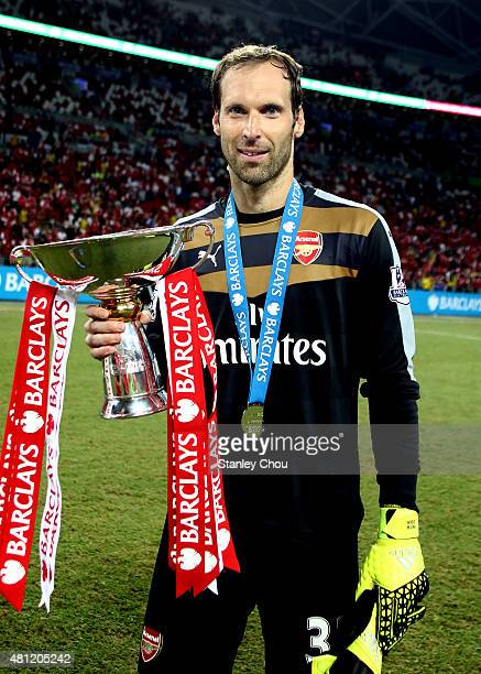 Petr Czech of Arsenal celebrates with the trophy after they defeated Everton 31 during the Barclays Asia Trophy final match between Arsenal and...