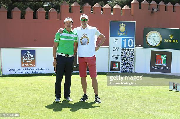 Petr Dedek from the Czech Republic poses with his coach/caddie David Carter on the first tee during the second round of the Trophee Hassan II Golf at...