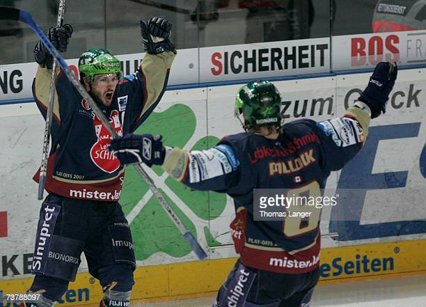 Petr Fical and Jamie Pollock of Nuremberg celebrate Fical's decisive goal during the DEL Play Off semi final match between Sinupret Ice Tigers and...