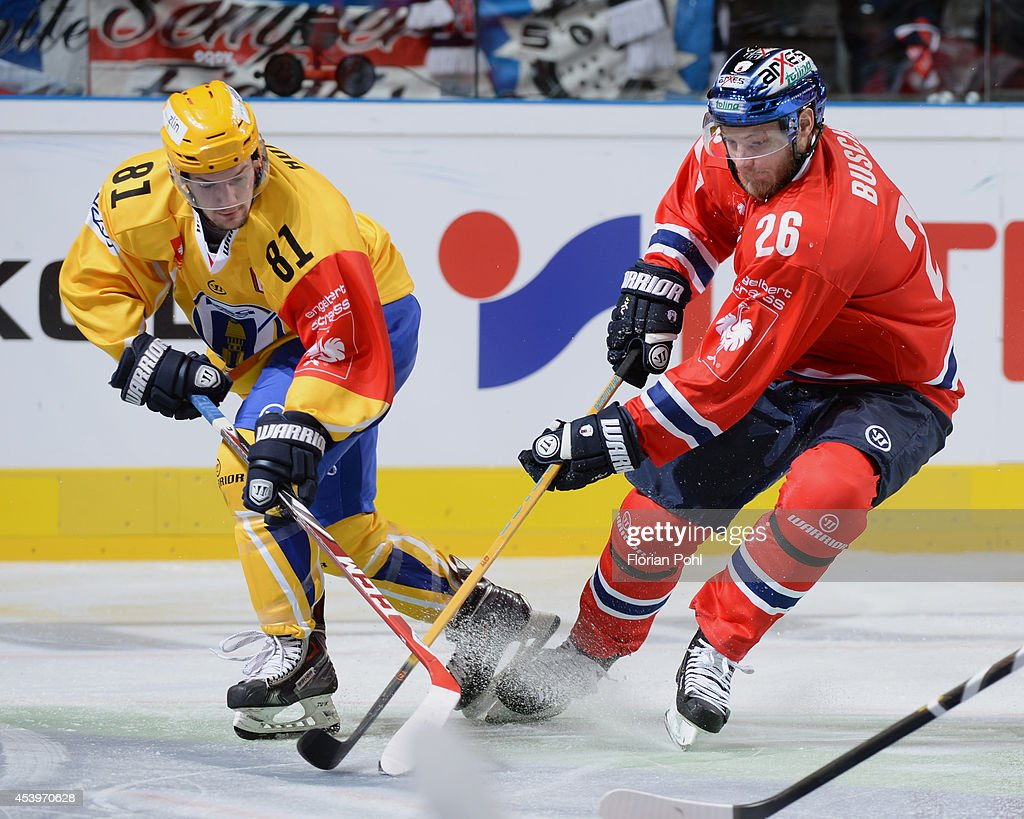 Petr Holik #81 of PSG Zlin struggles for the puck with Florian Busch #26 of Eisbären Berlin during the Champions Hockey League group stage game between Eisbaeren Berlin and HC Zlin on August 22, 2014 in Berlin, Germany.