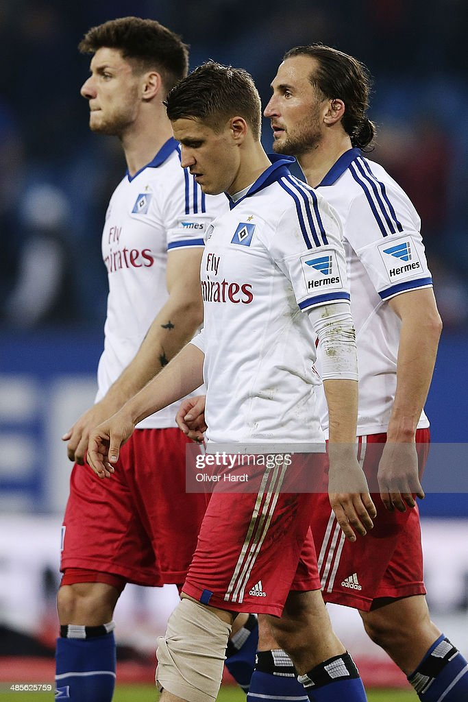 Petr Jiracek (R) and Ivo Ilicevic (C) of Hamburg appears frustrated after the Bundesliga match between Hamburger SV and VfL Wolfsburg at Imtech Arena on April 19, 2014 in Hamburg, Germany.