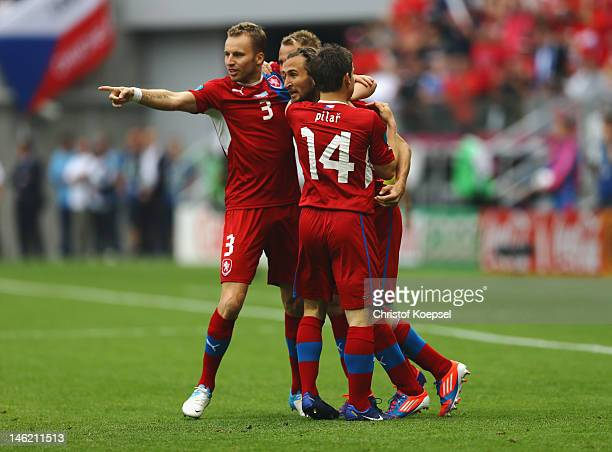 Petr Jiracek of Czech Republic celebrates scoring the opening goal with Vaclav Pilar and Michal Kadlec of Czech Republic during the UEFA EURO 2012...