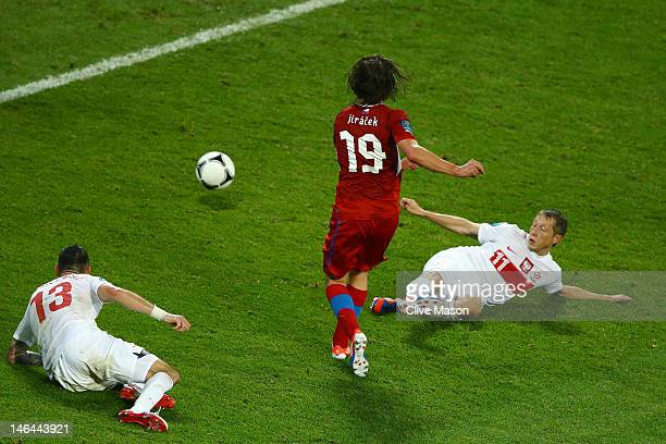 Petr Jiracek of Czech Republic scores their first goal past Marcin Wasilewski and Rafal Murawski of Poland during the UEFA EURO 2012 group A match...