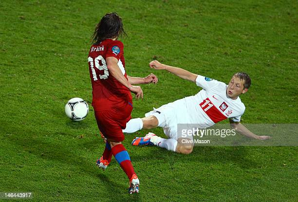 Petr Jiracek of Czech Republic scores their first goal past Rafal Murawski of Poland during the UEFA EURO 2012 group A match between Czech Republic...