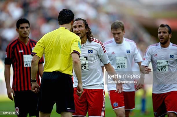Petr Jiracek of Hamburg argues with referee Wolfgang Stark during the Bundesliga match between Eintracht Frankfurt and Hamburger SV at...