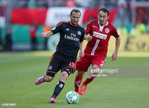 Petr Jiracek of Hamburg battles for the ball with Robert Berger of Cottbus during the DFB Cup match between FC Energie Cottbus and Hamburger SV at...