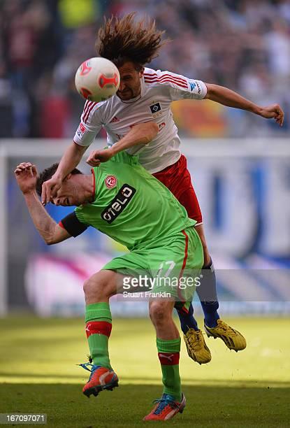 Petr Jiracek of Hamburg is challenged by Andreas Lambertz of Duesseldorf during the Bundesliga match between Hamburger SV and Fortuna Duesseldorf...