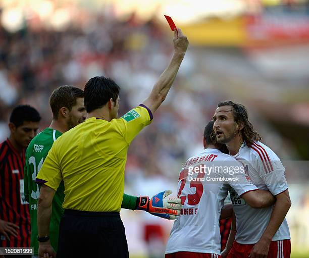 Petr Jiracek of Hamburg is shown a red card by referee Wolfgang Stark during the Bundesliga match between Eintracht Frankfurt and Hamburger SV at...