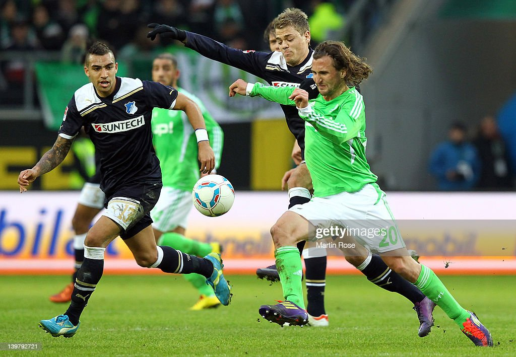 Petr Jiracek (R) of Wolfsburg and Boris Vukcevic (C) of Hoffenheim battle for the ball during the Bundesliga match between VfL Wolfsburg and 1899 Hoffenheim at the Volkswagen Arena on February 25, 2012 in Wolfsburg, Germany.