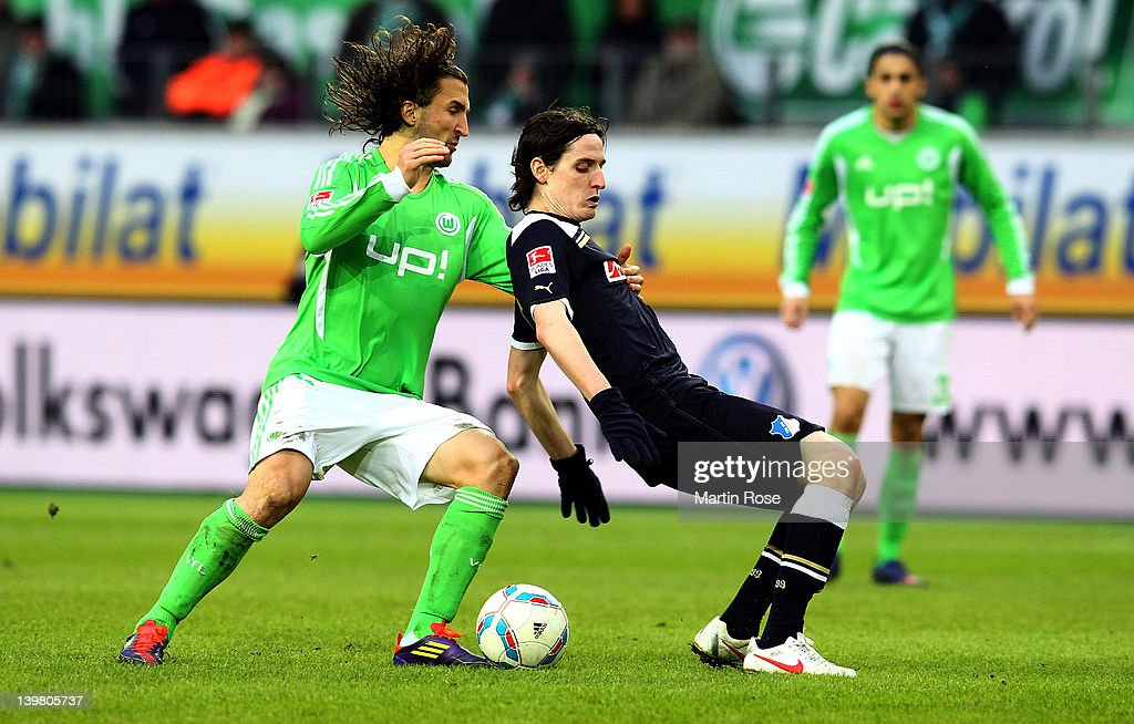 Petr Jiracek (L) of Wolfsburg and Sebastian Rudy (R) of Hoffenheim battle for the ball during the Bundesliga match between VfL Wolfsburg and 1899 Hoffenheim at the Volkswagen Arena on February 25, 2012 in Wolfsburg, Germany.