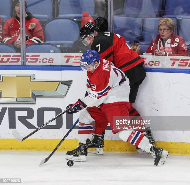 Petr Kodýtek of Czech Republic gains possession of the puck after checking Cale Makar of Canada during the first period of play in the IIHF World...