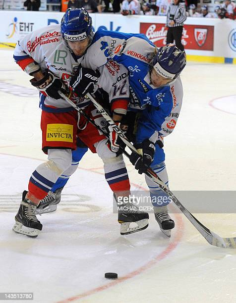 Petr Koukal of Czech Republic fights for the puck with Antti Pihlstrom of Finland during their Czech Hockey games tournament part of the EURO Hockey...