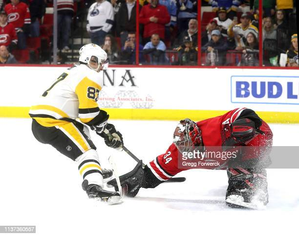 Petr Mrazek of the Carolina Hurricanes comes out of the crease to make a save on a shoot out attempt by Sidney Crosby of the Pittsburgh Penguins...