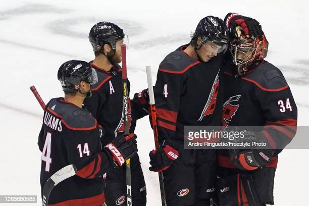 Petr Mrazek of the Carolina Hurricanes Haydn Fleury and Justin Williams celebrate after defeating the New York Rangers 41 in Game Two of the Eastern...