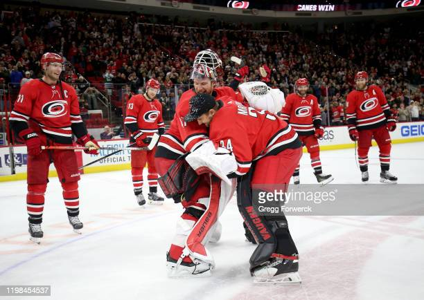 Petr Mrazek of the Carolina Hurricanes participates in the Storm Surge with teammate James Reimer after defeating the Philadelphia Flyers during an...