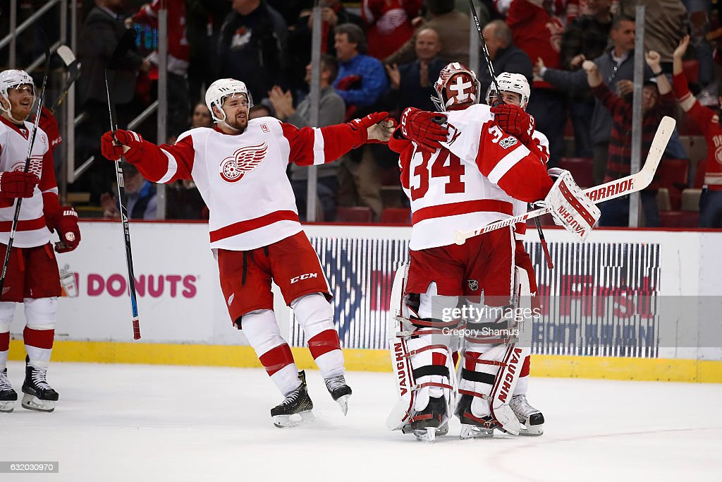 Petr Mrazek #34 of the Detroit Red Wings celebrates a 6-5 shootout win over the Boston Bruins with Tomas Tatar #21 and Xavier Ouellet #61at Joe Louis Arena on January 18, 2017 in Detroit, Michigan.
