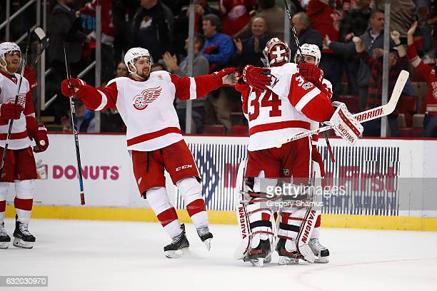 Petr Mrazek of the Detroit Red Wings celebrates a 65 shootout win over the Boston Bruins with Tomas Tatar and Xavier Ouellet Joe Louis Arena on...