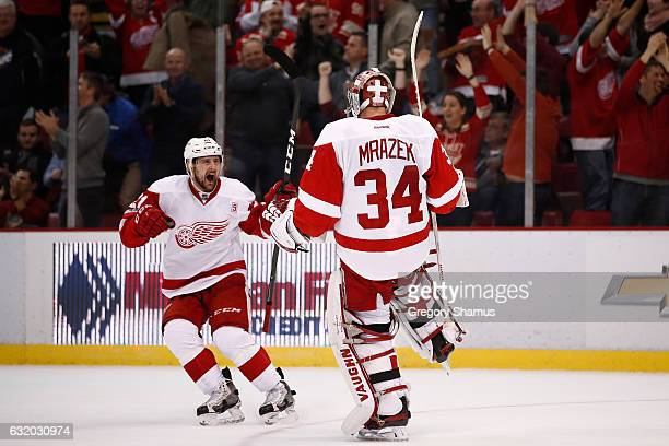 Petr Mrazek of the Detroit Red Wings celebrates a 65 shootout win over the Boston Bruins with Tomas Tatar at Joe Louis Arena on January 18 2017 in...