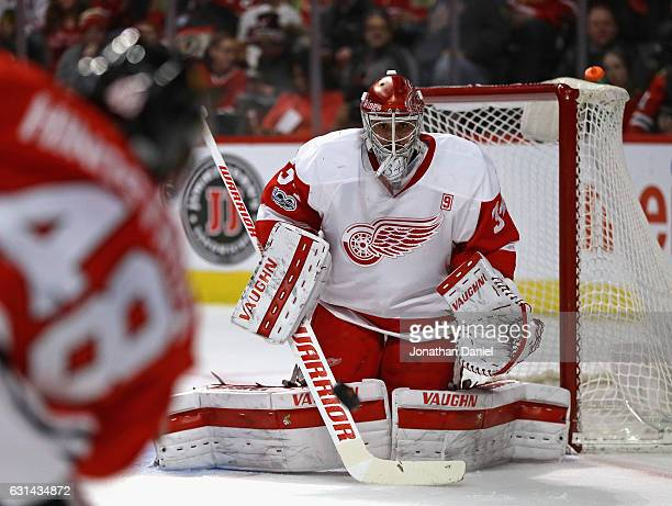 Petr Mrazek of the Detroit Red Wings drops to stop a shot by Vinnie Hinostroza of the Chicago Blackhawks at the United Center on January 10 2017 in...