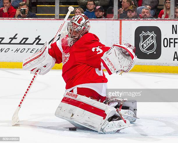 Petr Mrazek of the Detroit Red Wings makes a leg pad save during an NHL game against the Ottawa Senators at Joe Louis Arena on February 10 2016 in...
