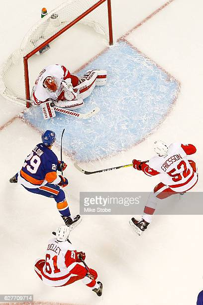 Petr Mrazek of the Detroit Red Wings makes a save against Brock Nelson of the New York Islanders at the Barclays Center on December 4 2016 in...
