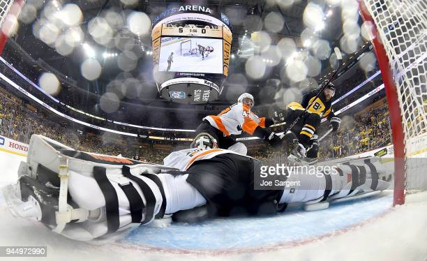 Petr Mrazek of the Philadelphia Flyers makes a save on a shot attempt by Phil Kessel of the Pittsburgh Penguins in Game One of the Eastern Conference...