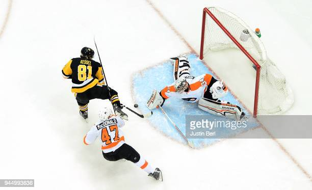 Petr Mrazek of the Philadelphia Flyers makes a save on a shot attempt by Phil Kessel of the Pittsburgh Penguins during the third period in Game One...