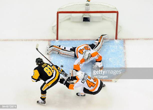 Petr Mrazek of the Philadelphia Flyers makes a save on Phil Kessel of the Pittsburgh Penguins in Game One of the Eastern Conference First Round...