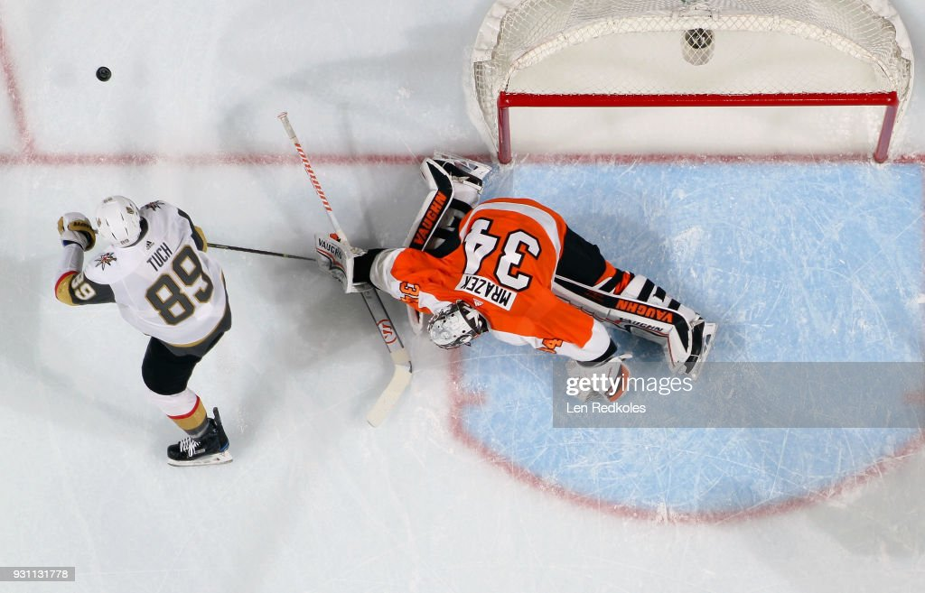 Petr Mrazek #34 of the Philadelphia Flyers protects his crease against a scoring chance by Alex Tuch #89 of the Vegas Golden Knights on March 12, 2018 at the Wells Fargo Center in Philadelphia, Pennsylvania. The Golden Knights went on to defeat the Flyers 3-2.