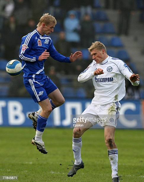Petr Nemov of FC Saturn Ramenskoe competes for the ball with Pavel Pogrebniak of FC Zenit St Petersburg during the Russian Football League...