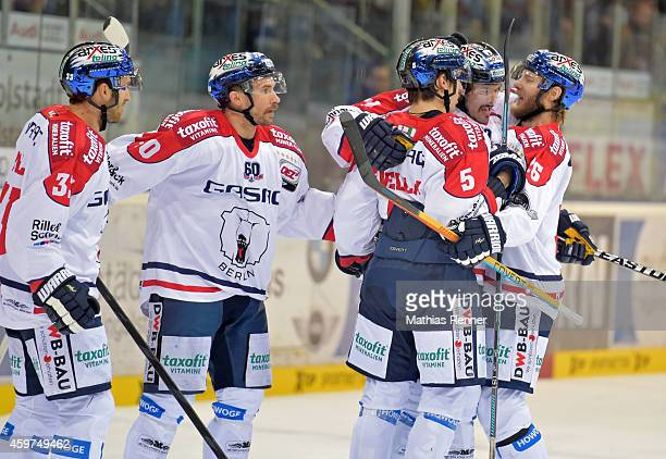 Petr Pohl, Darin Olver, Mark Bell, Alex Trivellato and Florian Busch of the Eisbaeren Berlin celebrate after scoring the 2:2 during the game between...