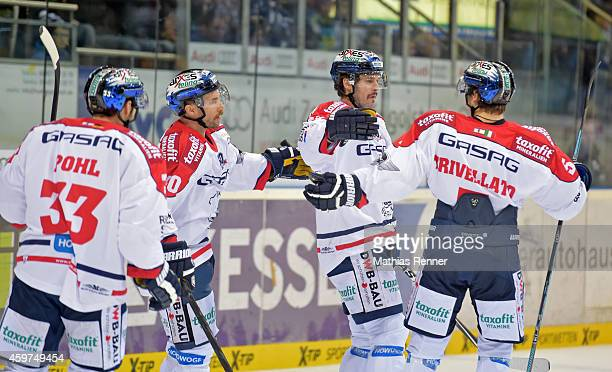 Petr Pohl, Darin Olver, Mark Bell and Alex Trivellato of the Eisbaeren Berlin celebrate after scoring the 2:2 during the game between ERC Ingolstadt...