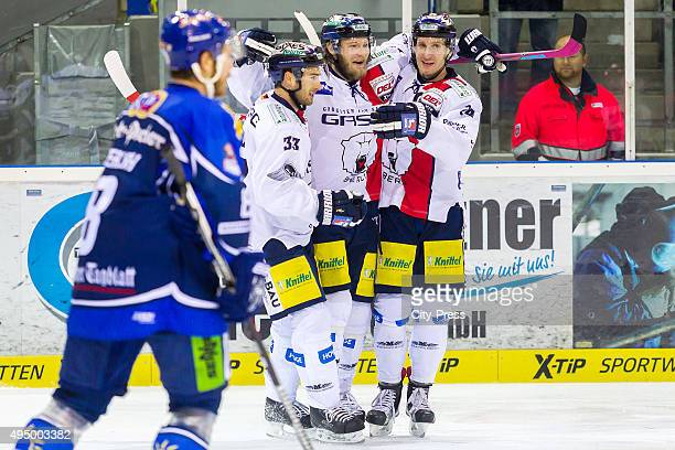 Petr Pohl Florian Busch and Andre Rankel of the Eisbaeren Berlin celebrate after scoring the 12 during the game between the Straubing Tigers and the...