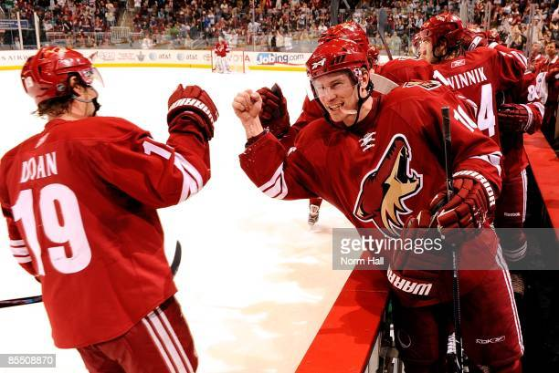 Petr Prucha of the Phoenix Coyotes celebrates the winning goal against the San Jose Sharks with teammate Shane Doan on March 17 2009 at Jobingcom...